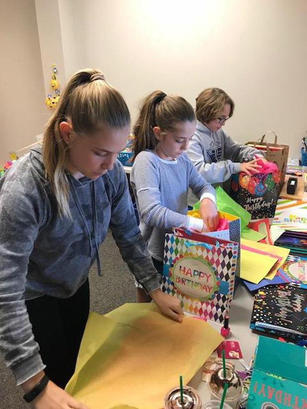 Ansley Vickar and her siblings Isabelle and Nelson volunteer with Birhday Joy, an organization dedicated to helping provide gifts to those in need.