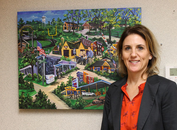 Inside her office at Temple Israel, Rachel Andreasson has a painting illustrating her family's business, which is connected to convenience stores such as On the Run. Photo: Eric Berger