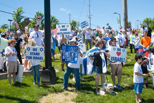Participants at the 'Walk in Support of Israel' hold signs at the corner of Schuetz Road and Lindbergh Boulevard. More than 500 people attended the event, held in May.Photo: Andrew Kerman