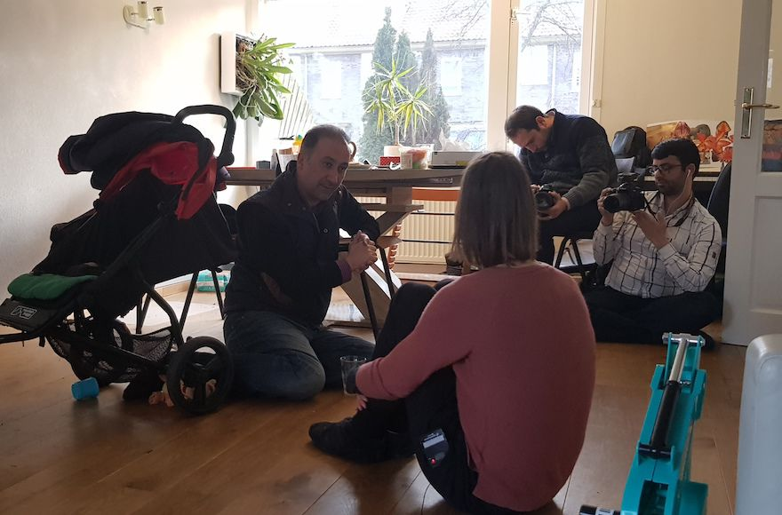 Mohammad+Delavari%2C+left%2C+and+two+members+of+his+filming+crew+interviewing+Iris+Tzur+at+her+home+in+Amsterdam%2C+March+1%2C+2018.+%28Cnaan+Liphshiz%29