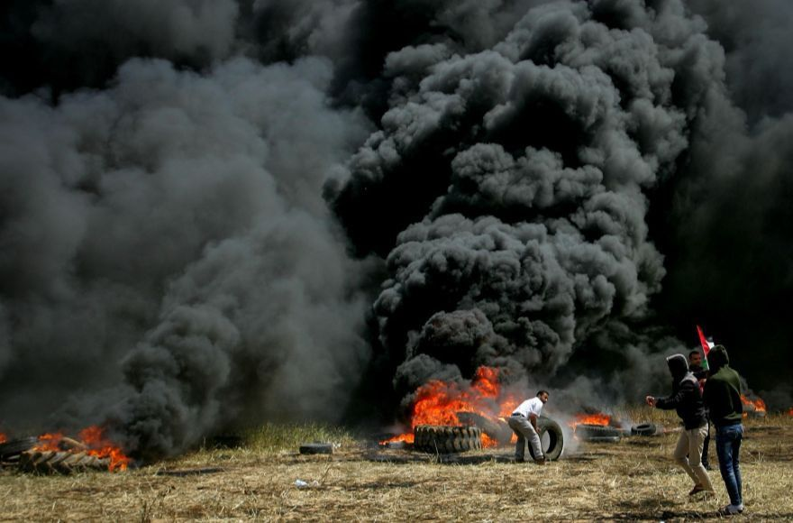 Palestinian protesters burn tires in the southern Gaza Strip on the border with Israel on April 6, 2018. Photo: Abed Rahim Khatib/ Flash90