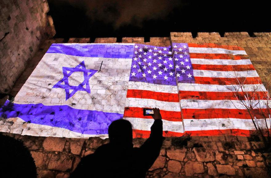 A+picture+taken+on+December+6%2C+2017+shows+a+giant+US+flag+screened+alongside+Israel%27s+national+flag+by+the+Jerusalem+municipality+on+the+walls+of+the+old+city.+US+President+Donald+Trump+recognized+the+disputed+city+of+Jerusalem+as+Israel%27s+capital+on+December+6%2C+2017%2C+and+kicked+off+the+process+of+relocating+the+US+embassy+there+from+Tel+Aviv.+The+old+city+lies+in+the+eastern+part+of+Jerusalem+which+was+under+Jordanian+control+from+Israel%27s+creation+in+1948+until+Israeli+forces+captured+it+during+the+1967+Six-Day+War%2C+and+Israel+later+annexed+it+in+a+move+not+recognised+by+the+international+community.+%2F+AFP+PHOTO+%2F+Ahmad+GHARABLI+%28Photo+credit+should+read+AHMAD+GHARABLI%2FAFP%2FGetty+Images%29