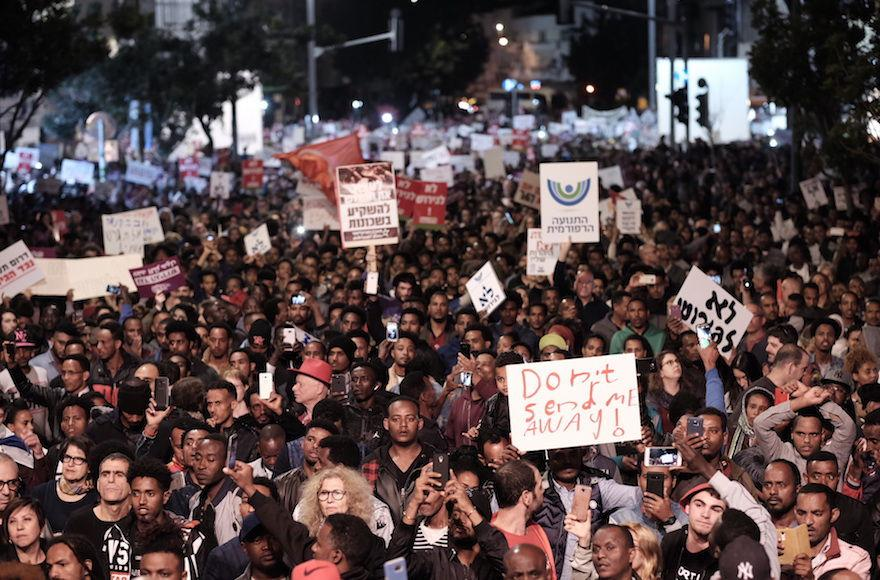 Thousands+of+African+asylum+seekers+and+human+rights+activists+at+a+separate+protest+in+Tel+Aviv%2C+Feb.+21%2C+2018.+%28Tomer+Neuberg%2FFlash90%29