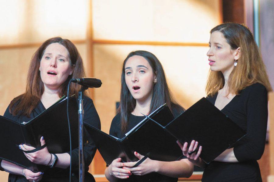 Alison Fox, Sarah Shulman and B'nai Amoona Cantor Sharon Nathanson sing during last year's Yom HaShoah commemoration, held at B'nai Amoona. This year's event will be April 15 at United Hebrew.