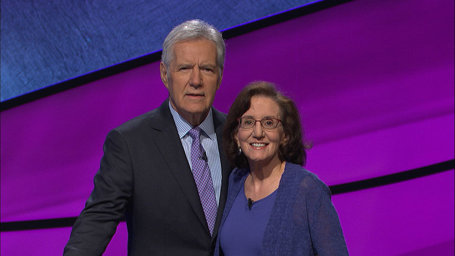 Creve Coeur resident Leslye Laderman poses with Alex Trebek during her recent appearance as a contestant on 'Jeopardy!' The episode will air Monday, April 30.