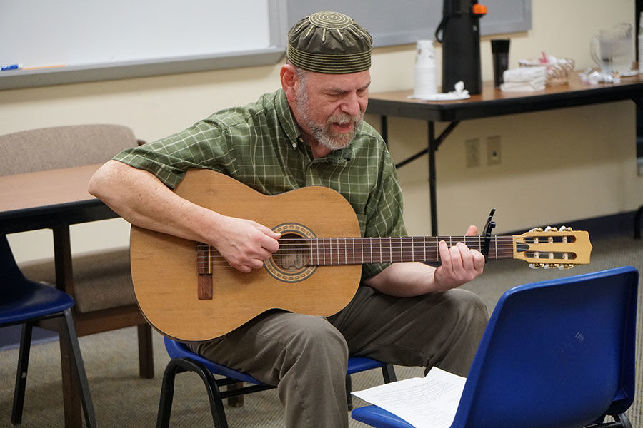 Will Soll teaches a Yiddish version of a Passover song at a Shaare Emeth Yiddish Club meeting.