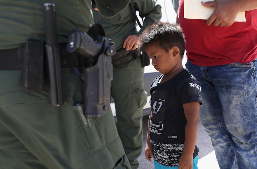 A+boy+from+Honduras+is+shown+being+taken+into+custody+by+U.S.+Border+Patrol+agents+near+the+U.S.-Mexico+Border+near+Mission%2C+Texas%2C+June+12%2C+2018.+%28John+Moore%2FGetty+Images%29