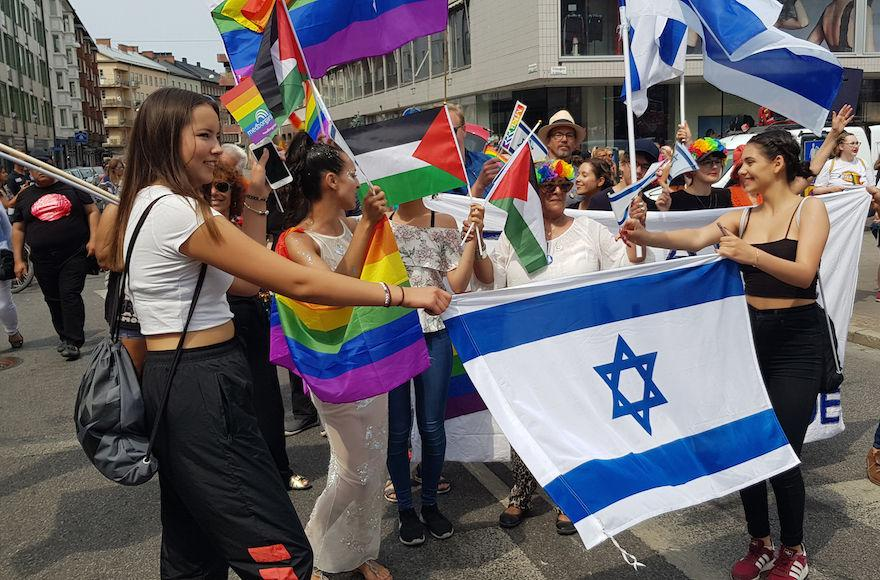 Ilana+Edner%2C+marching+behind+the+Israeli+flag%2C+with+participants+of+the+Jewish+contingent+of+the+gay+pride+parade+in+Malmo%2C+Sweden%2C+June+10%2C+2018.+%28Cnaan+Liphshiz%29