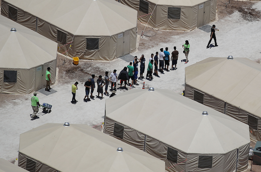 Children+and+workers+at+a+tent+encampment+recently+built+near+the+Tornillo+Port+of+Entry+in+Tornillo%2C+Texas%2C+June+19%2C+2018.