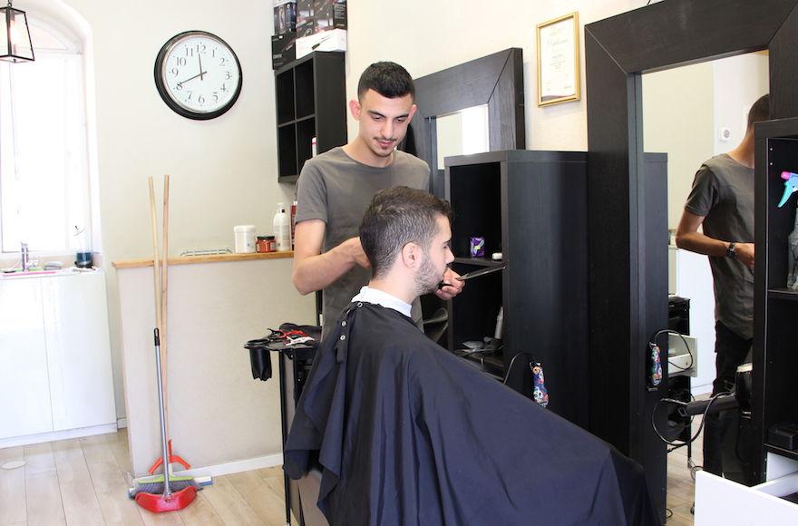 Ido+Vital%E2%80%99s+hair+salon+is+located+in+the+popular+Mahane+Yehuda+market+in+Jerusalem.+%28Tracy+Frydberg%29