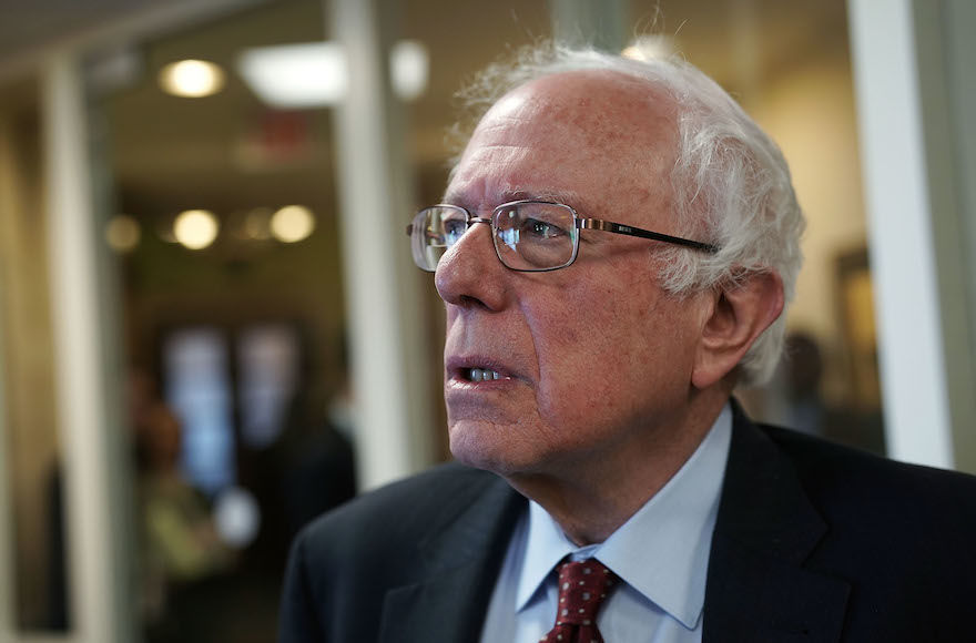 Sen.+Bernie+Sanders+at+a+news+conference+at+the+Capitol%2C+March+7%2C+2018.+%28Alex+Wong%2FGetty+Images%29