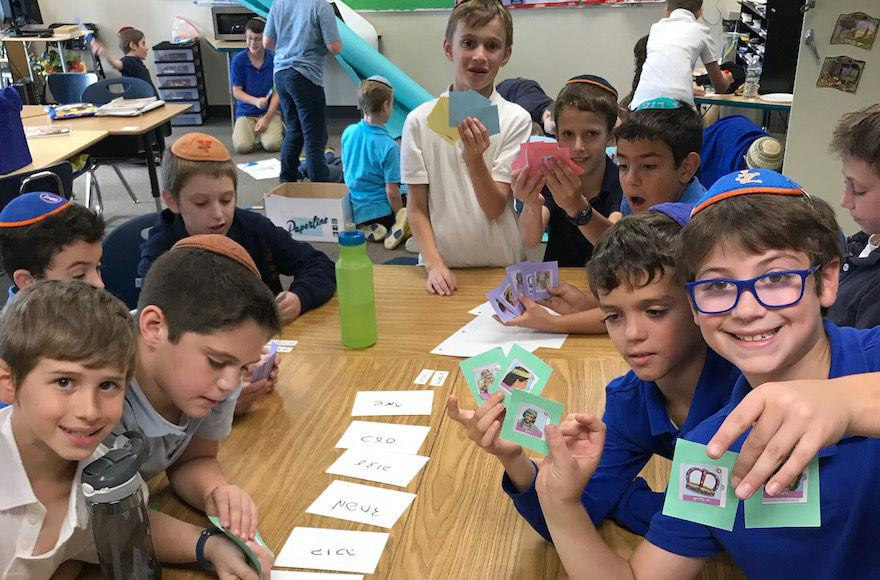 Fourth+graders+at+Yeshivat+Noam+in+Paramus%2C+N.J.%2C+play+a+game+involving+characters+in+the+biblical+story+of+Joseph.+%28Yaakov+Nadler%29