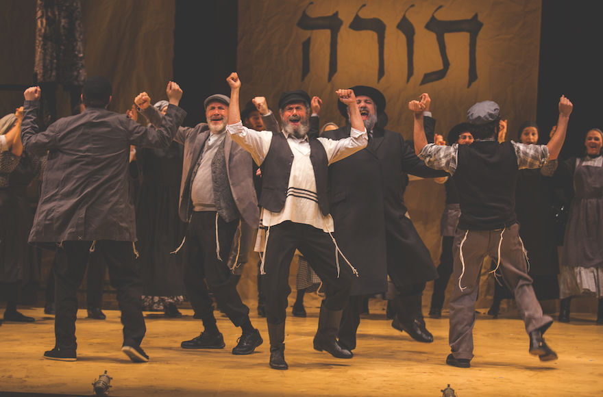 Steven+Skybell%2C+center%2C+as+Tevye+and+ensemble+in+the+National+Yiddish+Theatre+Folksbiene%E2%80%99s+production+of+%E2%80%9CFiddler+on+the+Roof.%E2%80%9D+%28Victor+Nechay%2FProperPix%29