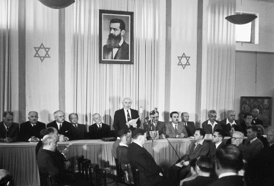 David+Ben-Gurion+%28First+Prime+Minister+of+Israel%29+publicly+pronouncing+the+Declaration+of+the+State+of+Israel%2C+May+14+1948+in+Tel+Aviv%2C+beneath+a+large+portrait+of+Theodor+Herzl%2C+founder+of+modern+political+Zionism%2C+in+the+old+Tel+Aviv+Museum+of+Art.%C2%A0