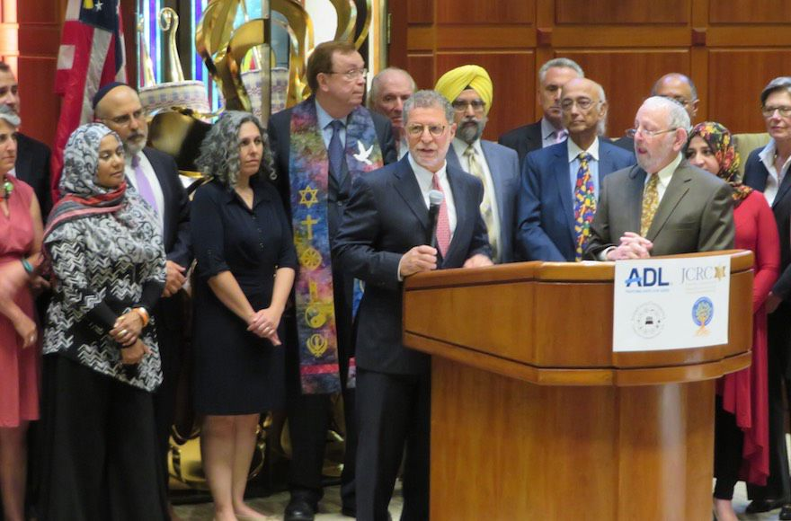 Rabbi+Bruce+Lustig+of+Washington+Hebrew+Congregation+is+surrounded+by+clergy+of+multiple+faiths+as+he+helps+launch+a+weekend+of+counterprotests+against+white+supremacist+marchers+in+Washington%2C+D.C.%2C+Aug.+10%2C+2018.+%28Ron+Kampeas%29