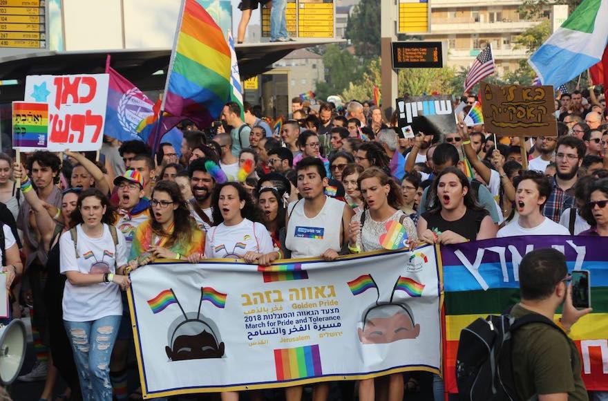 Tens+of+thousands+march+through+the+streets+of+Jerusalem+in+the+annual+Pride+Parade%2C+Aug.+2%2C+2018.+%28Adi+Eddy%2FCourtesy+of+Jerusalem+Open+House+for+Pride+and+Tolerance%29