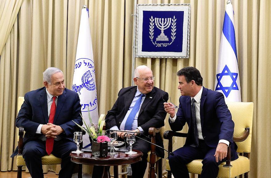 Prime+Minister+Benjamin+Netanyahu%2C+left%2C+President+Reuven+Rivlin+and+the+head+of+the+Mossad%2C+Yossi+Cohen%2C+at+an+awards+ceremony+in+Jerusalem+to+recognize+13+employees+of+Israel%E2%80%99s+intelligence+agency%2C+Dec.+13%2C+2017.+%28Kobi+Gideon%2FWikimedia+Commons%29