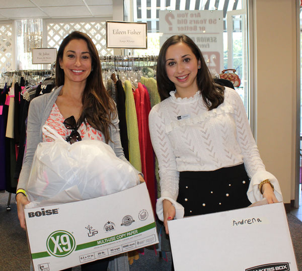 Andrena Grillo-Reavill (left) shops with a Saks Fifth Avenue personal stylist at the Couturier sale.
