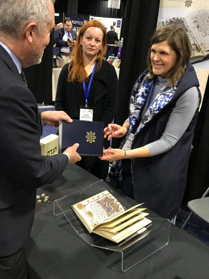 A stunning new facsimile of the 14th-century Sarajevo Hagaddah was on display, and for sale, by the National Museum of Bosnia and Herzegovina,in the exhibit hall at the Association of Jewish Studies convention. Photo: Penny Schwartz