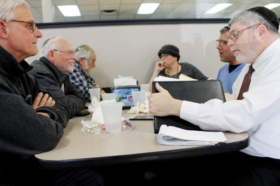 Leaders of local Jewish cemeteries, funeral homes and a monument company meet monthly at Kohns Kosher Deli to discuss their industry. (From left) Dennis Hrubes (Berger Memorial Chapel); Barry Needle (United Cemetery Association; Jim Singman (Beth Hamadrosh Hagodol Cemetery); Anita Feigenbaum (Chesed Shel Emeth Society); Donald Meissner, (New Mount Sinai Cemetery); and Jonathan Usprich (Rosenbloom Monument).Photo: Eric Berger