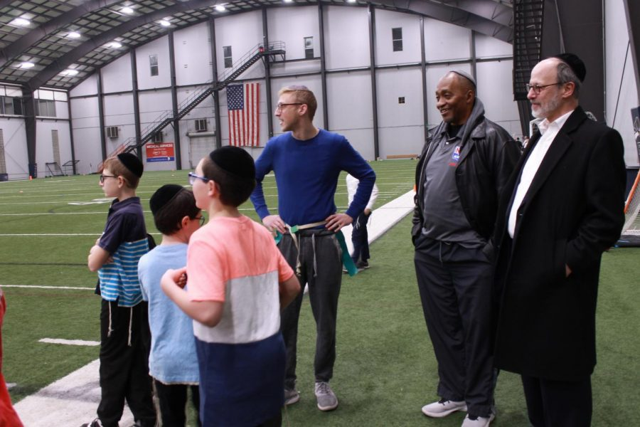 Calvin Murray (second from right), a retired NFL player, visited St. Louis for the Torah and Turf flag football tournament and to talk with different Jewish groups about his journey from Christianity to Orthodox Judaism. The Torah and Turf program was one of this years Kranzberg Family Foundation grant recipients. Photo: Eric Berger