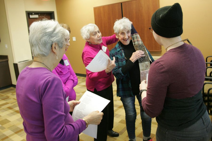 Sharon Shattan places a scarf on Nancy Baum's shoulder during a small-group acting exercise at a St. Louis NORC drama class in December. Photo: Mike Sherwin