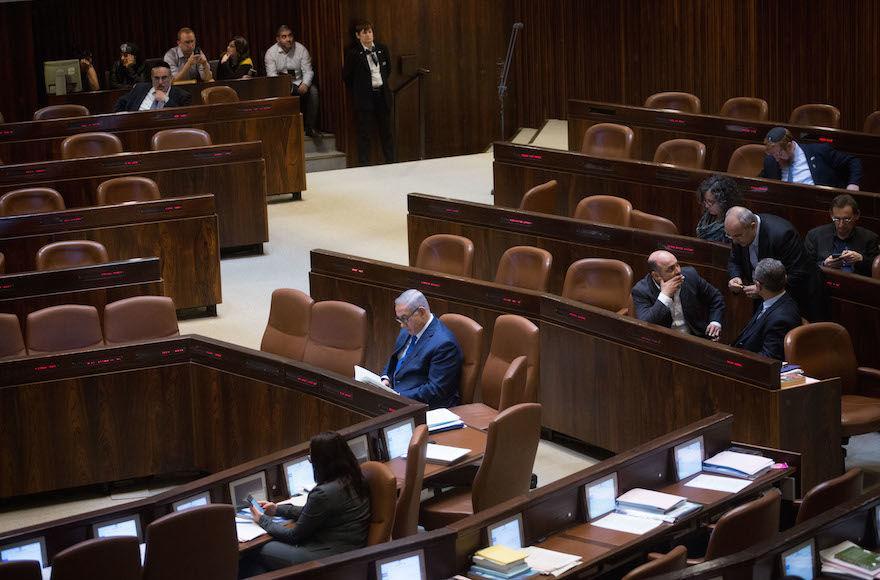 Israeli Prime Minister Benjamin Netanyahu seen in the Israeli parliament during a plenum session, March 12, 2018. Photo: Miriam Alster/Flash90
