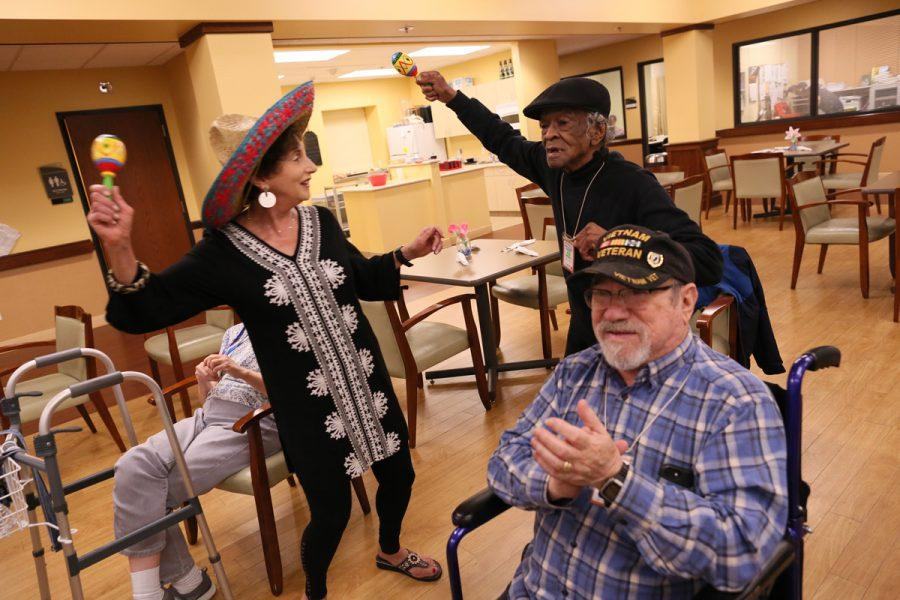 Volunteer Alice Ludmer dances with participants at the J's Adult Day Center during a Cinco de Mayo celebration. Photo: Bill Motchan