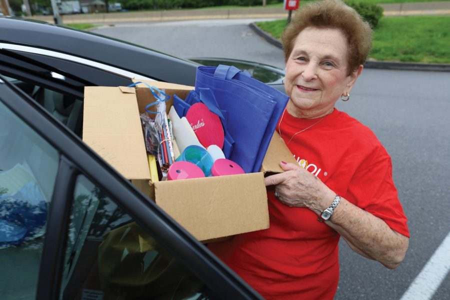 Reva+Davis%2C+a+retired+teacher%2C+has+become+an+integral+volunteer+with+National+Council+of+Jewish+Women%2C+the+Jewish+Community+Center+and+other+organizations.+Here%2C+she+carries+donated+items+for+NCJW%E2%80%99s+2019+Back+to+School%21+Store.+Photo%3A+Bill+Motchan