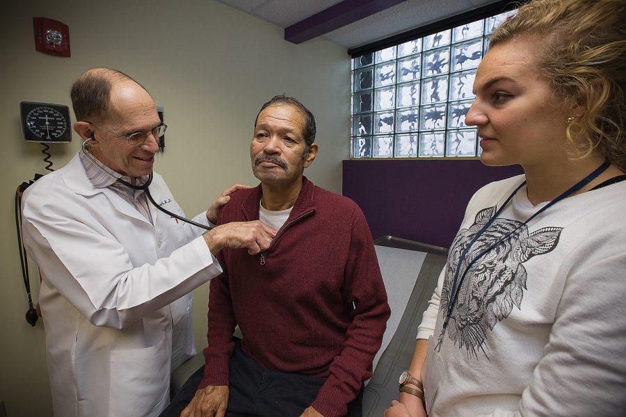 Dr. Gary Ratkin, a retired oncologist, meets with a patient at Casa de Salud, a low-cost health clinic in St. Louis city. PHOTO: ODELL MITCHELL JR./COURTESY CASA DE SALUD