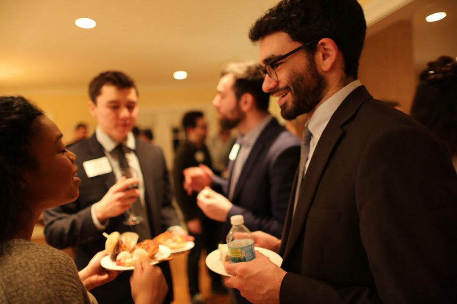 Yoni Blumberg (right) schmoozes with other guests at a Meet New People Party earlier this year. The parties, organized by Karen Kalish, offer young professionals a chance to network.Photos: Bill Motchan