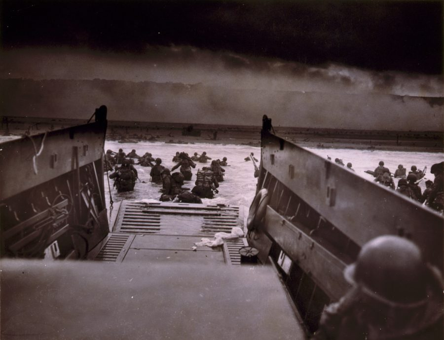 Above%3A+American+soldiers+wade+from+Coast+Guard+landing+barge+toward+the+beach+at+Normandy+on+D-Day%2C+June+6%2C+1944.%C2%A0Photo%3A+Robert+F.+Sargent%2FLibrary+of+Congress+Prints+and+Photographs+Division