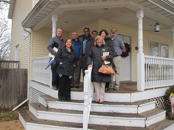 A 2016file photo shows members of the Jewish Fund for Human Needs committee with Vince Estrada of the Maplewood- Richmond Heights School District in front of Joe's Place, one of the agencies awarded a JFHN grant thatyear.