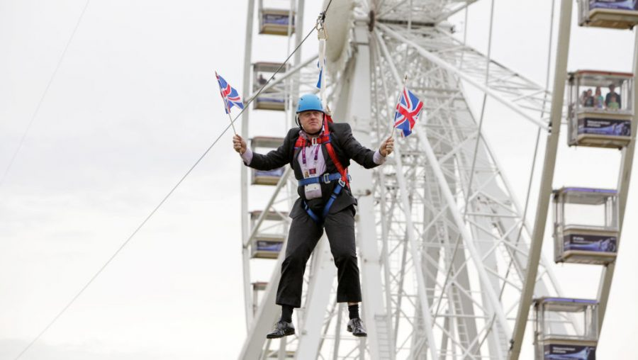 Boris+Johnson%2C+the+mayor+of+London%2C+waits+to+glide+on+a+zip+line+onto+the+Olympic+Park+in+London%2C+Aug.+1%2C+2012.+%28Barcroft+Media%2FBarcroft+Media+via+Getty+Images%29
