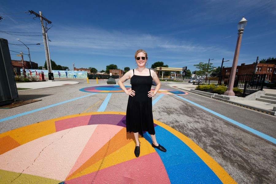 Ellie+Balk+with+the+mural+she+created+at+the+Chroma+Apartments+complex+in+the+Grove.+Photo%3ABill+Motchan