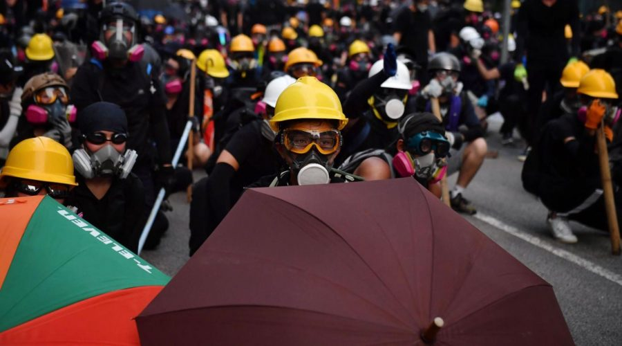Protesters+with+umbrellas+and+protective+gear+face+off+with+riot+police+at+Kowloon+Bay+in+Hong+Kong%2C+Aug.+24%2C+2019.+%28Lillian+Suwanrumpha%2FAFP%2FGetty+Images%29%C2%A0