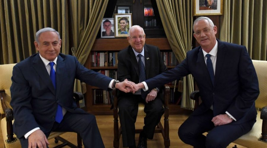 Prime Minister Benjamin Netanyahu, left, and Benny Gantz flank Israeli President Reuven Rivlin at the president's residence in Jerusalem, Sept. 23, 2019, They met to discuss forming a unity government. Photo: Haim Zach/Israeli Government Press Office