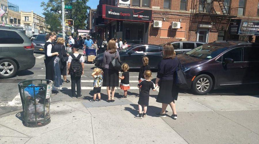 Women+and+children+wait+at+a+crosswalk+in+the+Orthodox+neighborhood+of+Borough+Park%2C+Brooklyn%2C+Sept.+3%2C+2019.+%28Ben+Sales%29%C2%A0