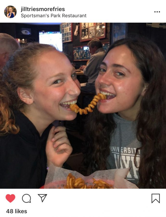 Jill+Goldwasser+%28left%29+and+Kaitlyn+Goldstein+%28right%29+eating+curly+fries+in+Jill%E2%80%99s+first+post+at+Sportsman%E2%80%99s+Park+in+Ladue.+Search+%40JillTriesMoreFries+on+Instagram+to+watch+her+current+videos.