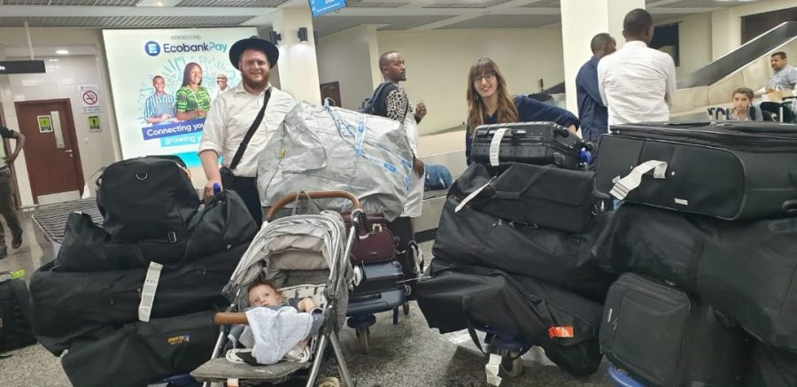 Rabbi+Chaim+and+Dina+Bar+Sella+and+8-month-old+Shneur+Zalman+arrive+in+Kigali%2C+Rwanda%2C+to+set+up+the+country%27s+first+Chabad+center.+%28Courtesy+of+Chabad%29