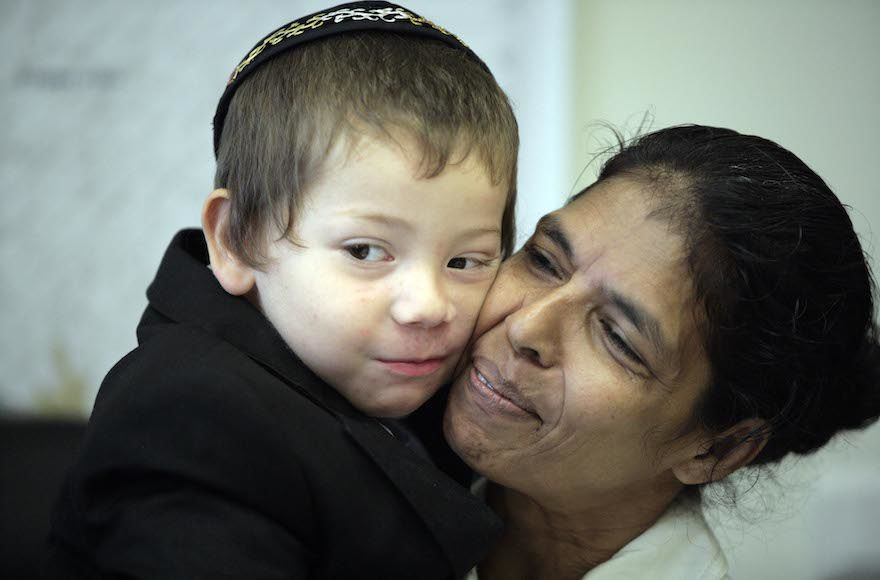 Moshe+Holtzberg+with+his+nanny+Sandra+in+2010.+She+has+followed+him+to+Israel+and+is+the+only+figure+in+his+life+left+from+India.+%28Abir+Sultan%2FFlash+90%29