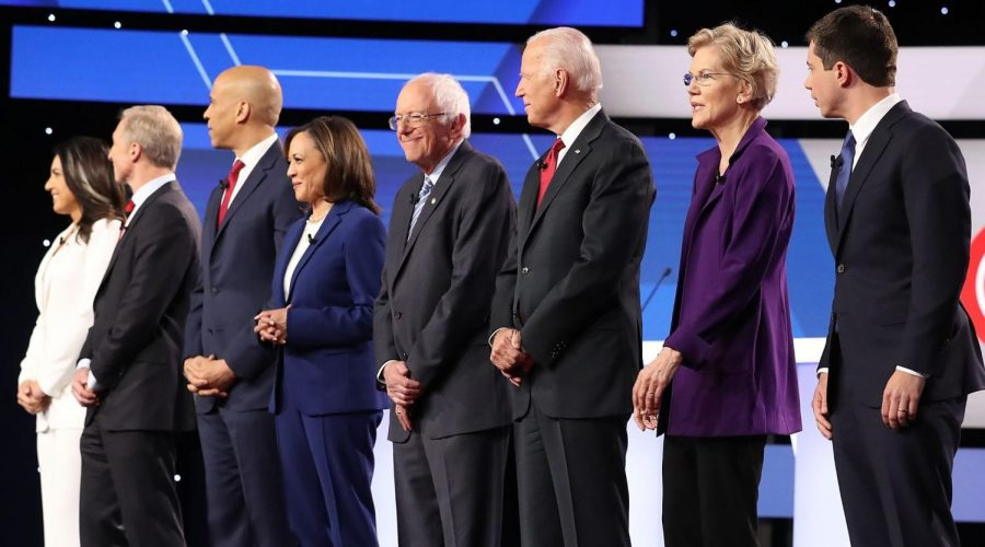 A+record+12+Democratic+presidential+candidates+stand+before+the+start+of+their+debate+at+Otterbein+University+in+Westerville%2C+Ohio%2C+Oct.+15%2C+2019.+%28Chip+Somodevilla%2FGetty+Images%29