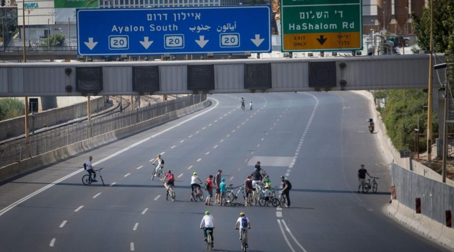 Israelis+ride+their+bicycles+along+the+empty+Ayalon+highway+in+Tel+Aviv%2C+on+Yom+Kippur%2C+Oct.+9%2C+2019.+The+roads+traditionally+are+empty+on+the+holiest+day+of+the+Jewish+year.+Photo%3A+Miriam+Alster%2FFlash+90