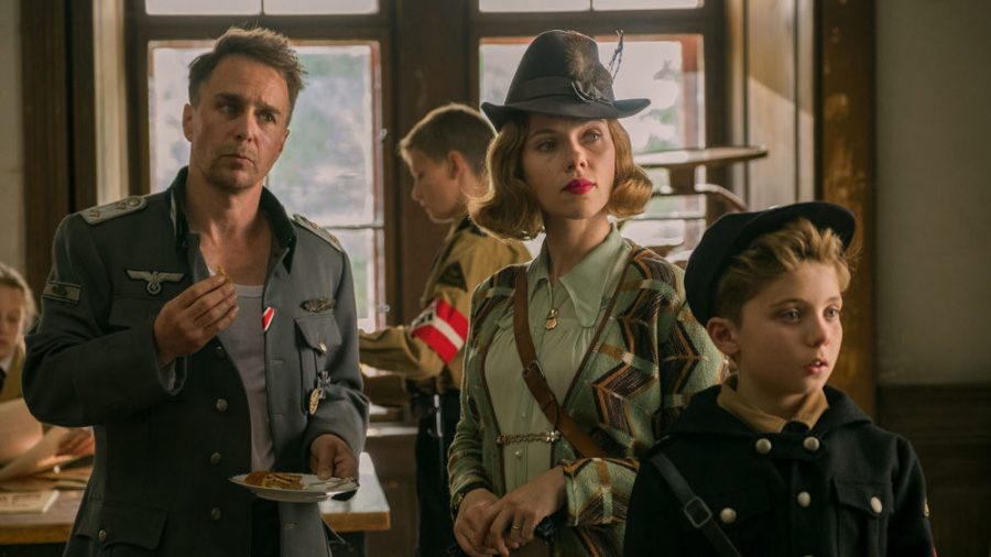 Scarlett Johansson (with Sam Rockwell, left, and Roman Griffin Davis) stars as a loving German mom in