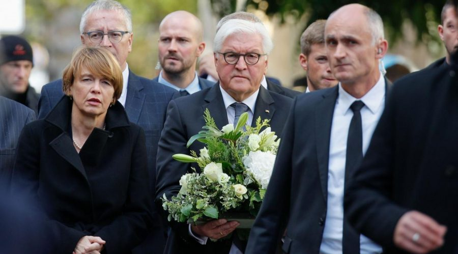 German+President+Frank-Walter+Steinmeier+carries+flowers+alongside+his+wife%2C+Elke+Buedenbender%2C+as+they+arrive+at+the+synagogue+in+Halle+one+day+after+a+gunman+shot+and+killed+two+people+near+a+synagogue+and+at+a+kebab+shop%2C+%2C+Oct.+10%2C+2019.+Photo%3A+Axel+Schmidt%2FAFP+via+Getty+Images