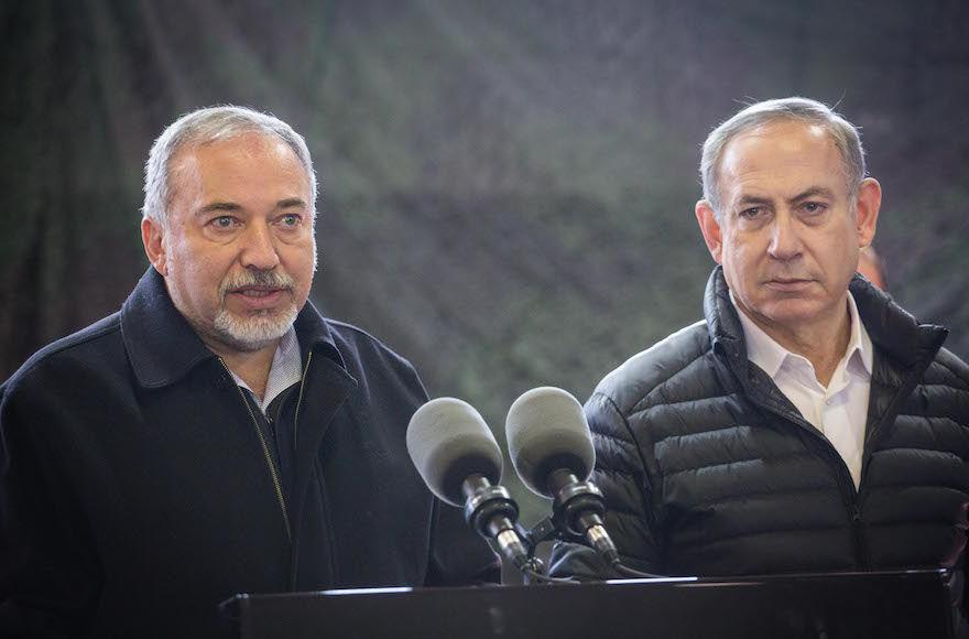Prime Minister Benjamin Netanyahu, right, and then-Israeli Defense Minister Avigdor Liberman speak to the media, Jan. 10, 2017. (Hadas Parush/Flash90)