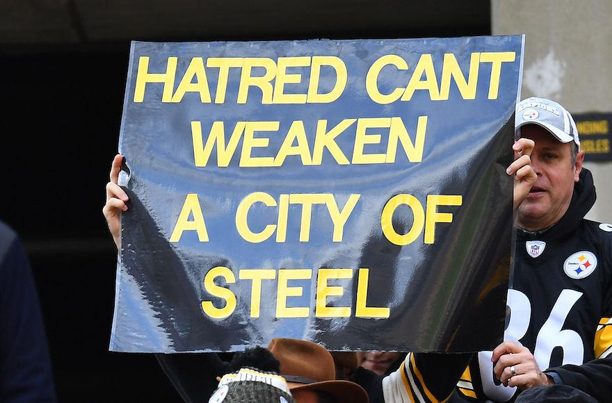A+fan+holds+up+a+sign+to+honor+the+victims+of+the+shooting+at+the+Tree+of+Life+Synagogue+during+the+game+between+the+Pittsburgh+Steelers+and+the+Cleveland+Browns+at+Heinz+Field+in+Pittsburgh%2C+Oct.+28%2C+2018.+%28Joe+Sargent%2FGetty+Images%29
