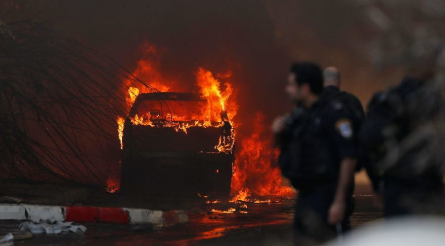 A+vehicle+parked+in+front+of+a+factory+that+was+hit+with+rockets+fired+from+the+Gaza+Strip+catches+fire+in+the+southern+Israeli+town+of+Sderot%2C+Nov.+12%2C+2019.+Photo%3A+Ahmad+Gharabli%2F+AFP+via+Getty+Images