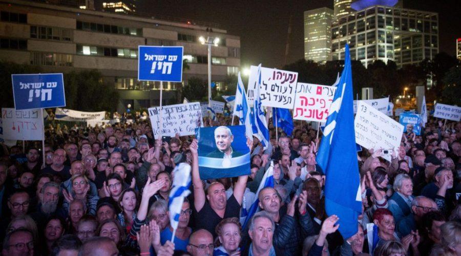 Supporters+of+Israeli+Prime+Minister+Benjamin+Netanyahu+at+a+rally+in+Tel+Aviv+in+support+of+him+and+against+his+indictment+on+corruption+charges+on+Nov.+26%2C+2019.+%28Miriam+Alster%2FFlash90%29