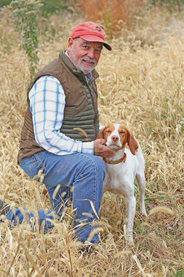 Dr. Burton Wice and Daisee, a Brittany Spaniel. She holds the dual title of field champion and grand field champion from the American Kennel Club.